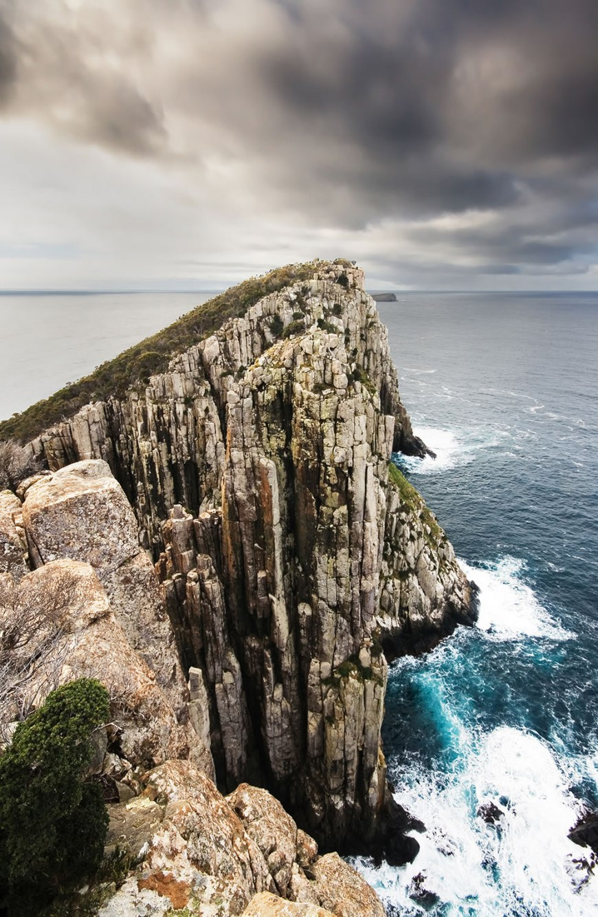 Candlestick, Cape Huay, The Tasman Peninsula, Tasmania, Australia. The Lanterns and the Hippolyte Rocks are visible behind.