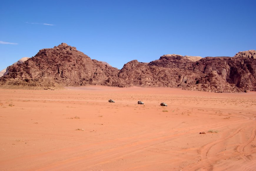 3 trucks - what are they carrying across the desert of wadi rum