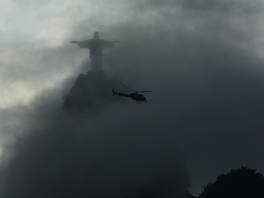 Christ and helicopter on a cloudy day