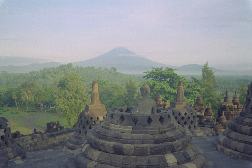 Mt. Merapi erupts from Borobudur with lush jungle