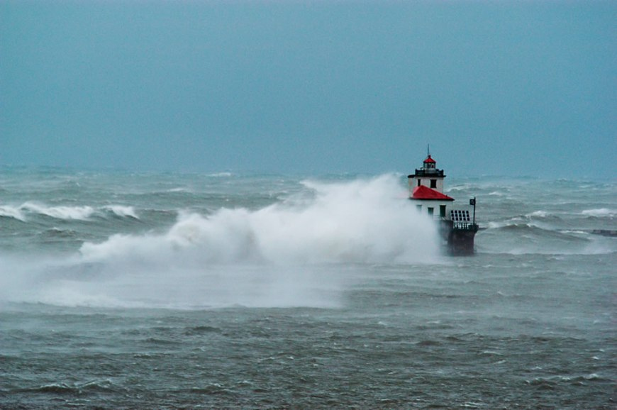 The Oswego Lighthouse is awash with waves during a November 2003 storm with 80 mph winds
