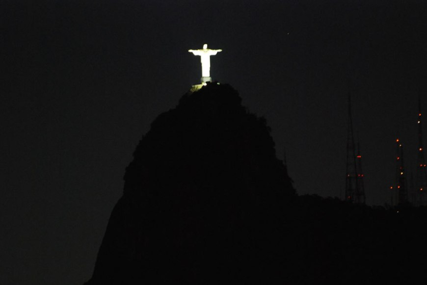 The statue of Christ The Redeemer at night, taken from Sugar Loaf Mountain, Rio de Janeiro, Brazil