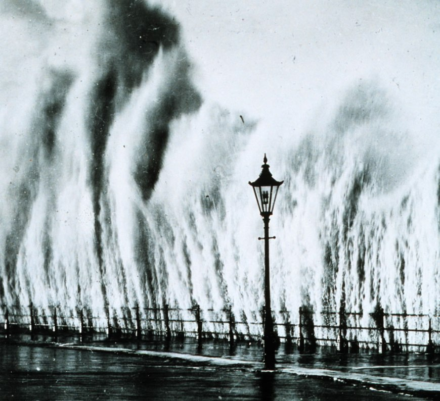 Waves striking seawall give appearance of geysers erupting