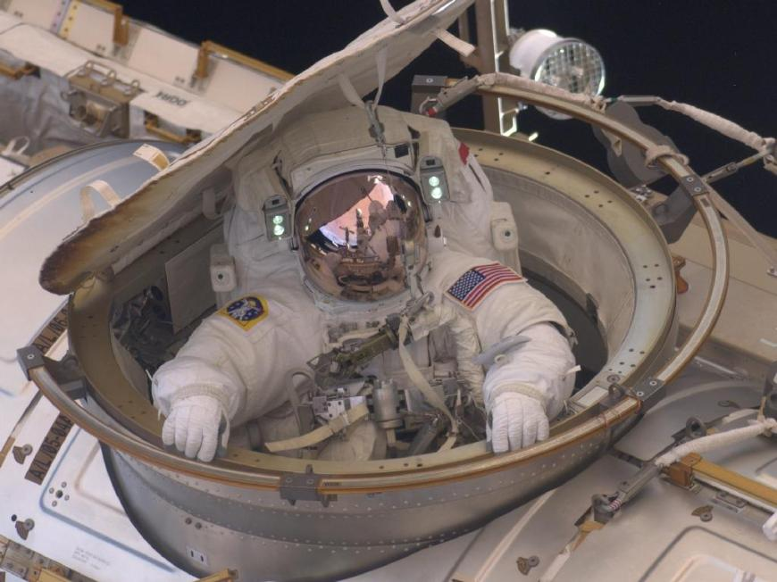 Astronaut Andrew Feustel reenters the space station after completing n 8-hour, 7-minute spacewalk