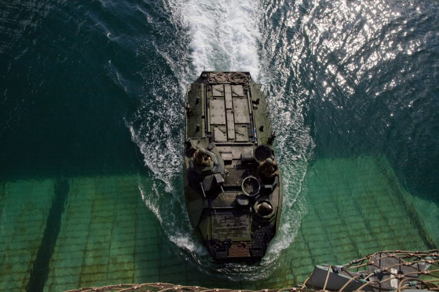 U.S. Marines attached to a security cooperation task force return an assault amphibian vehicle to USS Gunston Hall