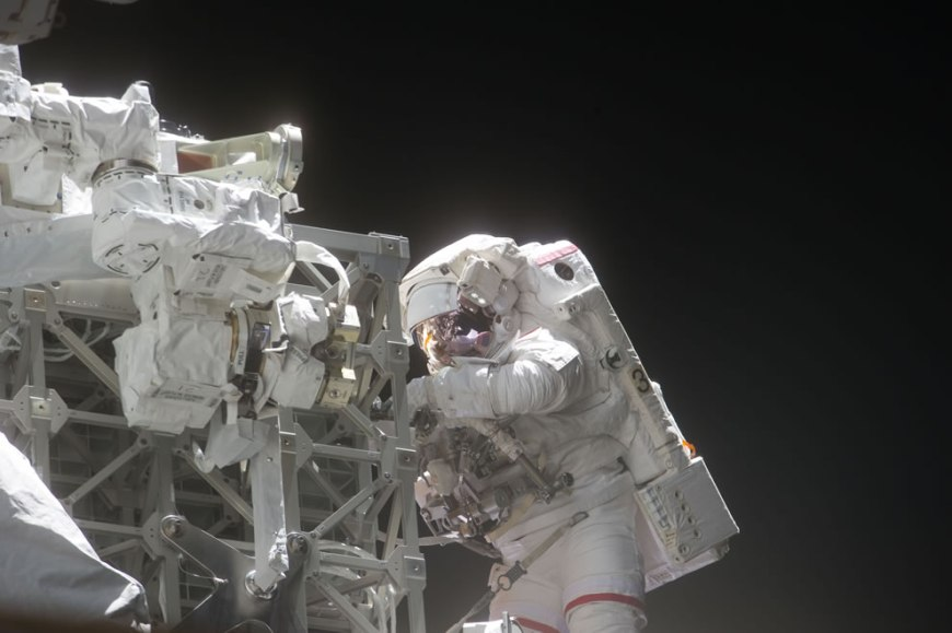 With his Extravehicular Mobility Unit spacesuit backdropped against the blackness of space, NASA astronaut Andrew Feustel is pictured during the STS-134 mission's third spacewalk