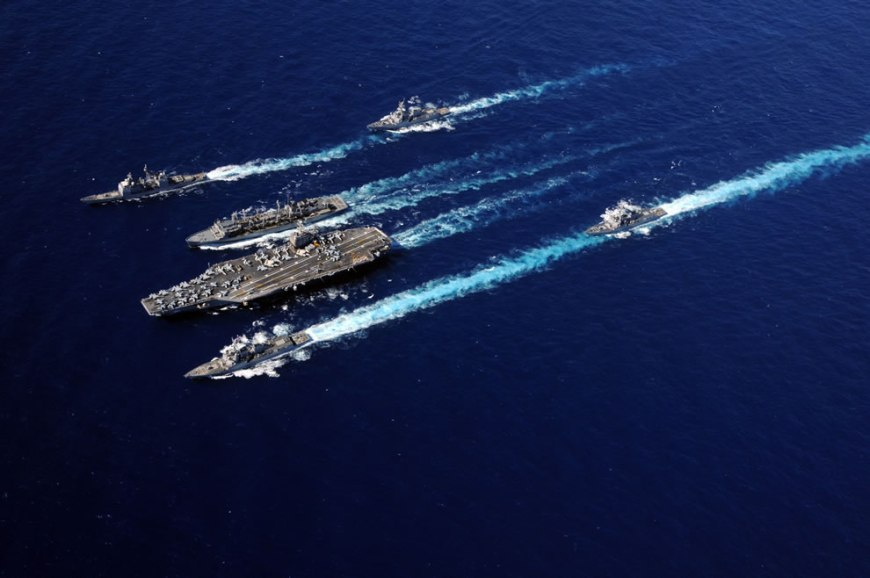 aircraft carrier USS Abraham Lincoln (CVN 72), bottom center, and the Military Sealift Command fast combat support ship USNS Rainier
