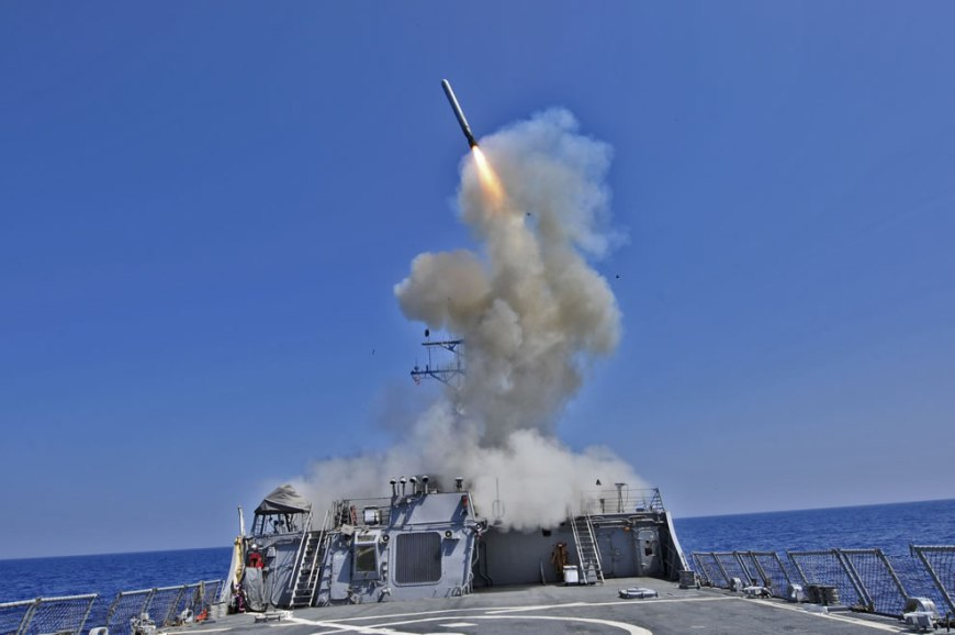 guided missile destroyer USS Barry (DDG 52) launches a Tomahawk cruise missile