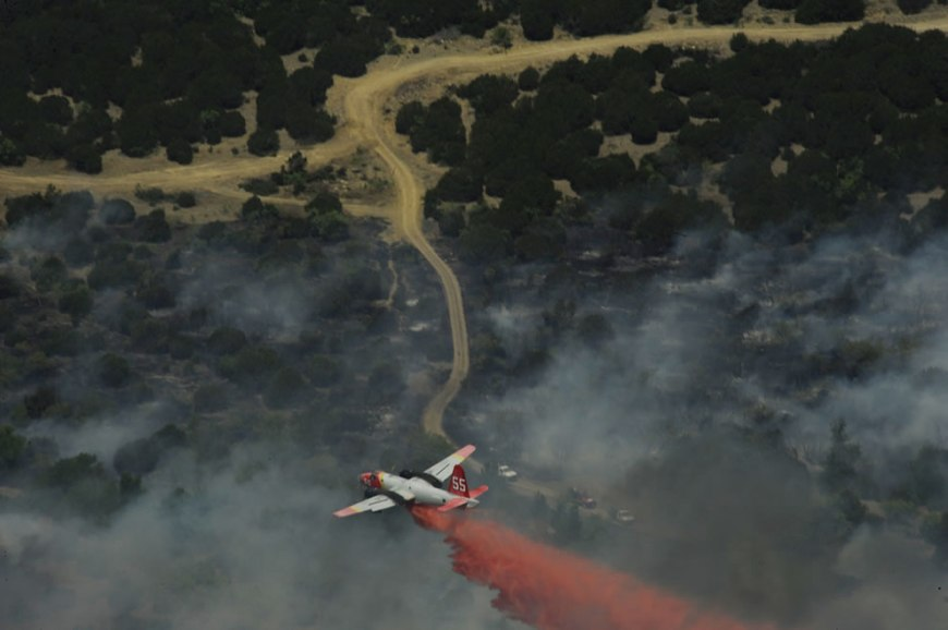 Minden Air Lockheed SP-2H Neptune tanker drops flame retardant over Texas wildfires