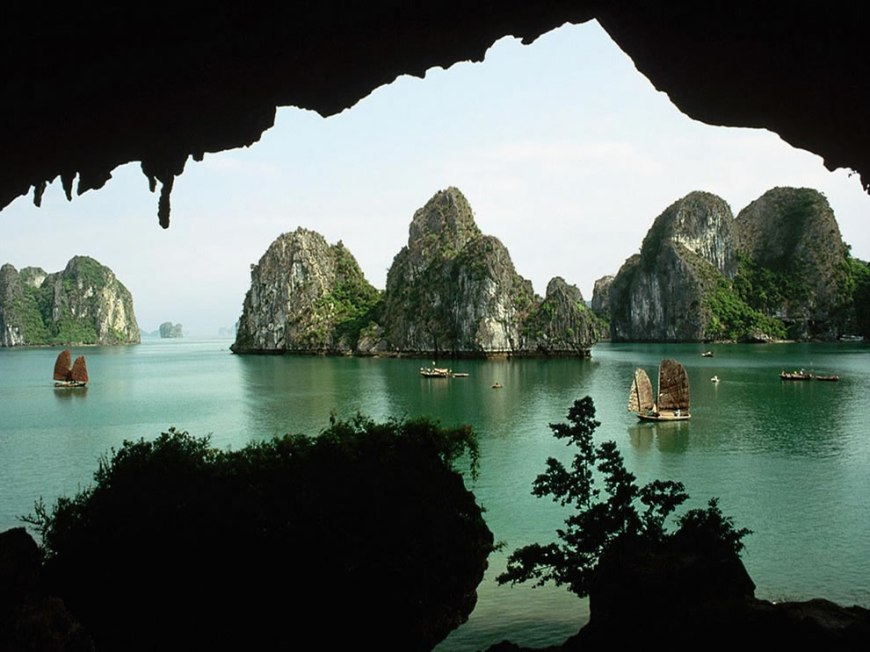 Peering out of cave at dream destination Ha Long Bay
