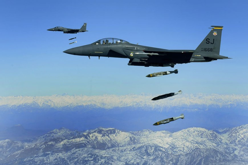 U.S. Air Force F-15E Strike Eagle aircraft from the 335th Fighter Squadron drop 2,000-pound joint direct attack munitions on a cave in eastern Afghanistan