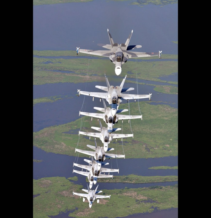 U.S. Navy F/A-18 Hornet aircraft assigned to the River Rattlers, Strike Fighter Squadron (VFA) 204, fly in a column formation