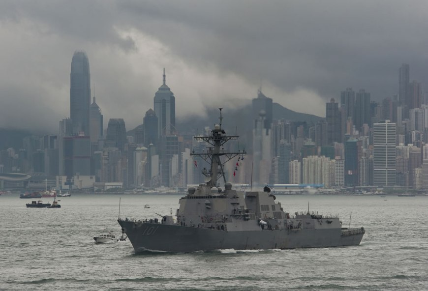 U.S. Navy guided-missile destroyer USS Gridley arrives in Hong Kong alongside the aircraft carrier USS Carl Vinson