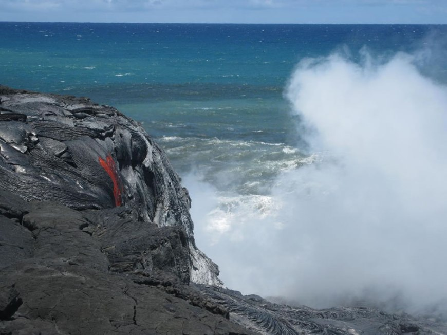 A surge of lava that broke out and view of lava cascading down the sea cliff