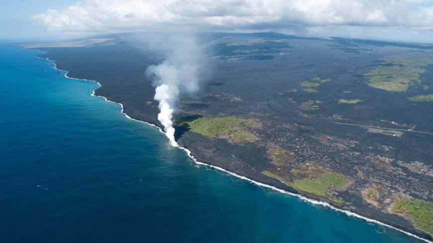 aerial of lava flowing into ocean at hawaii volcanoes national park