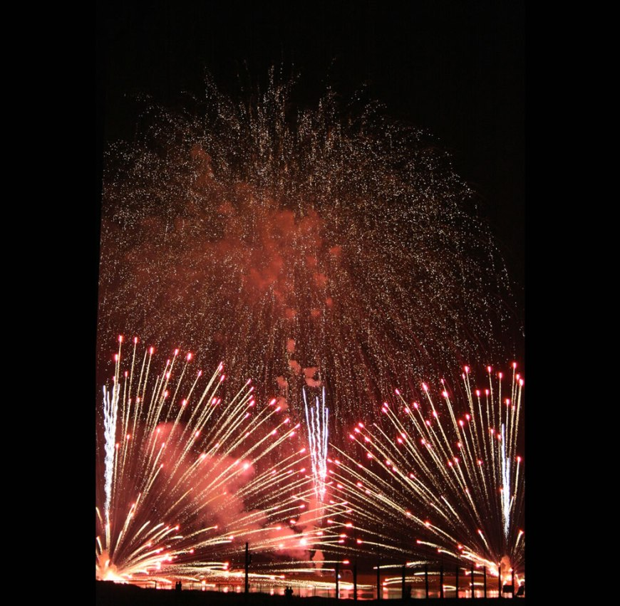 Fireworks illuminate Penny Lake during the Marine station's fireworks display July 4