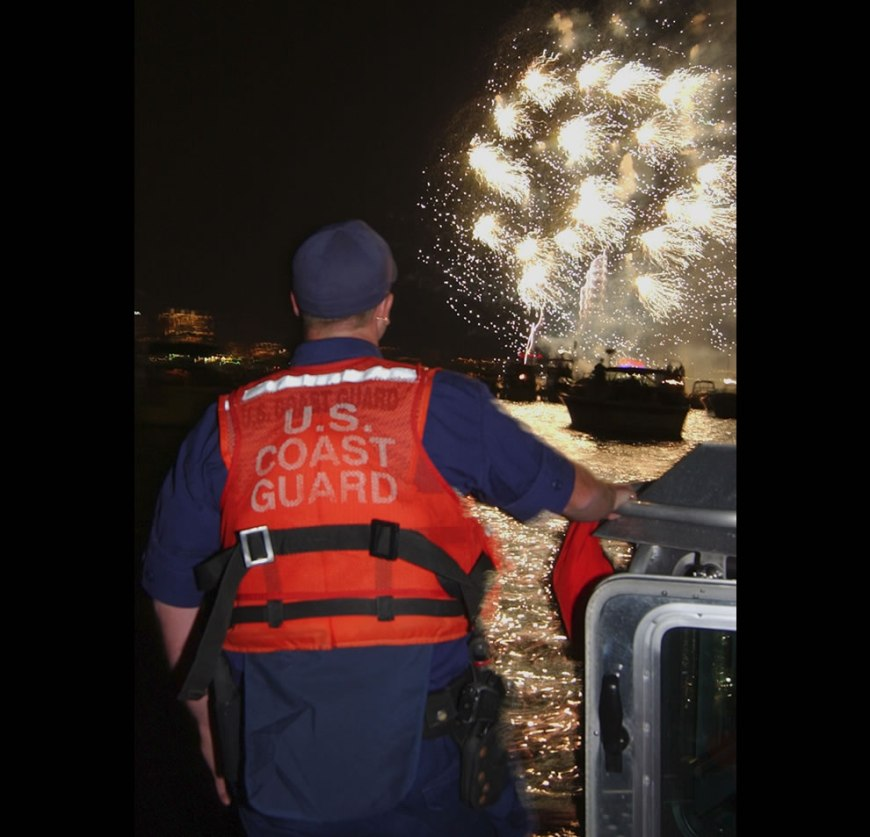 member of Coast Guard Station Boston's Harbor Defense Team maintains a sharp lookout during the Fourth of July fireworks to celebrate our nation's independence and freedom