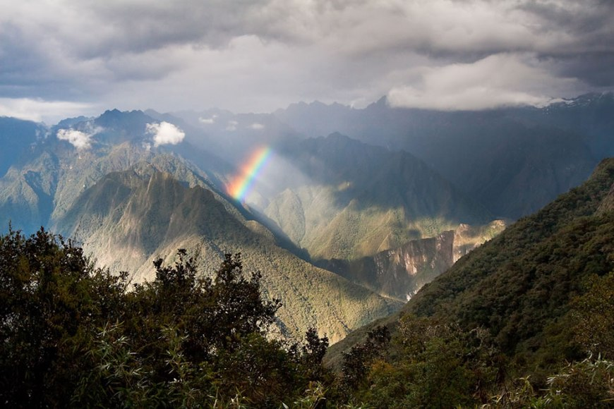 Rainbow over the Andes and valley
