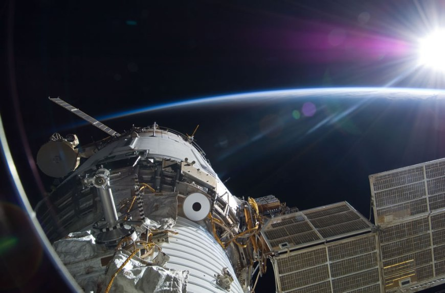Bright sun greets the International Space Station in this Nov. 22 scene from the Russian section of the orbital outpost, photographed by one of the STS-129 crew members