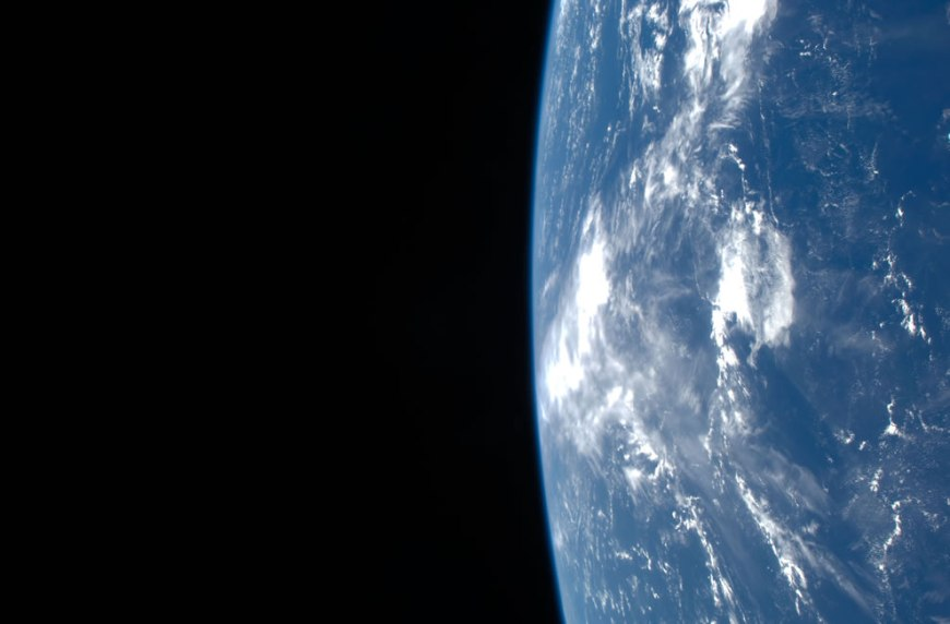 Earth's horizon and the blackness of space are featured in this image photographed by an STS-125 crewmember on the Earth-orbiting Space Shuttle Atlantis