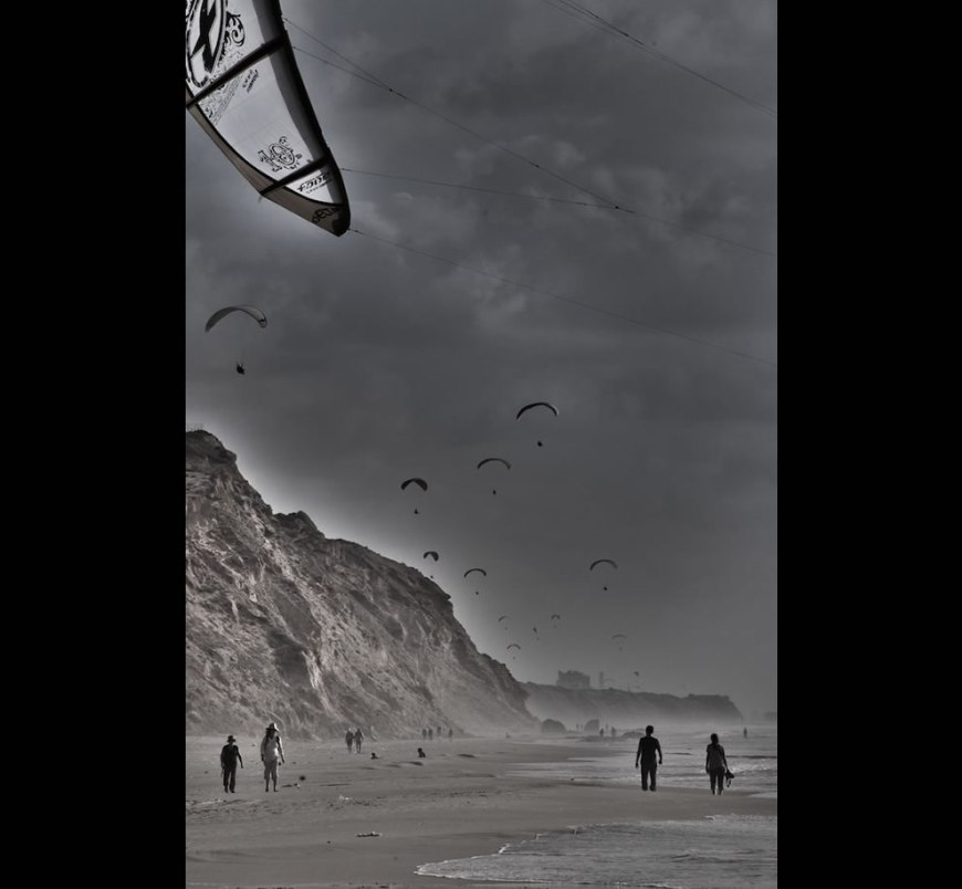 Windy day at the beach - paragliders