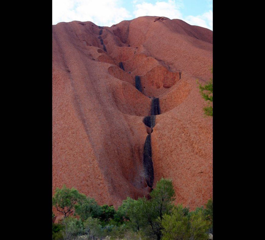 Uluru erosion - During the rains, water cascades down this eroding the soft sandstone