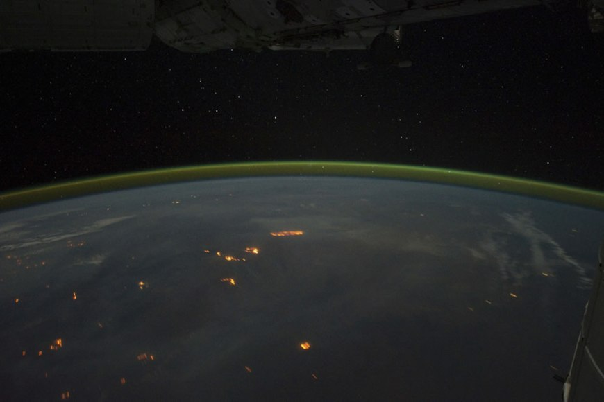 Wildfires with smoke plumes faintly visible in the night sky of Australia