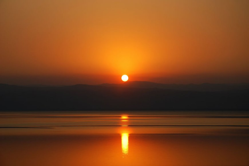 Dead Sea Setting - The Dead Sea is so dense, it makes even the sun float on its surface