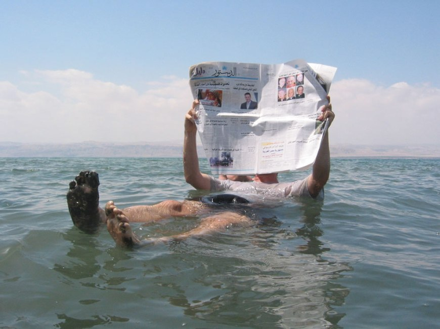 Floating on the Dead Sea and reading to newspaper