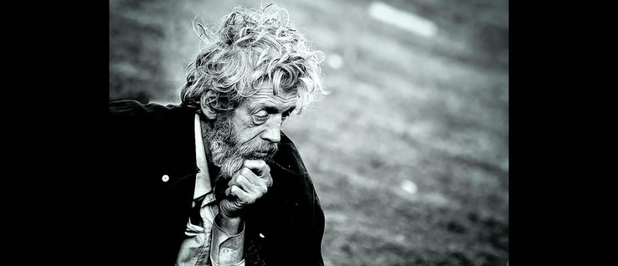 homeless man lost in thought