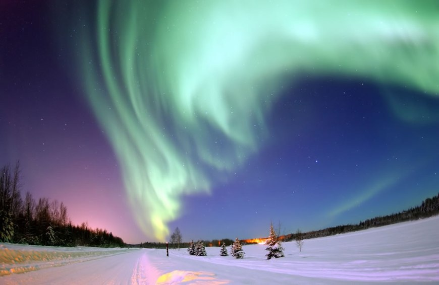 Arctic portal -- Eielson Air Force Base, Alaska — The Aurora Borealis, or Northern Lights, shines above Bear Lake