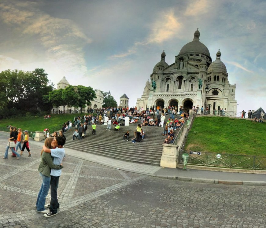 Couple kissing at Basilica of the Sacred Heart, Paris