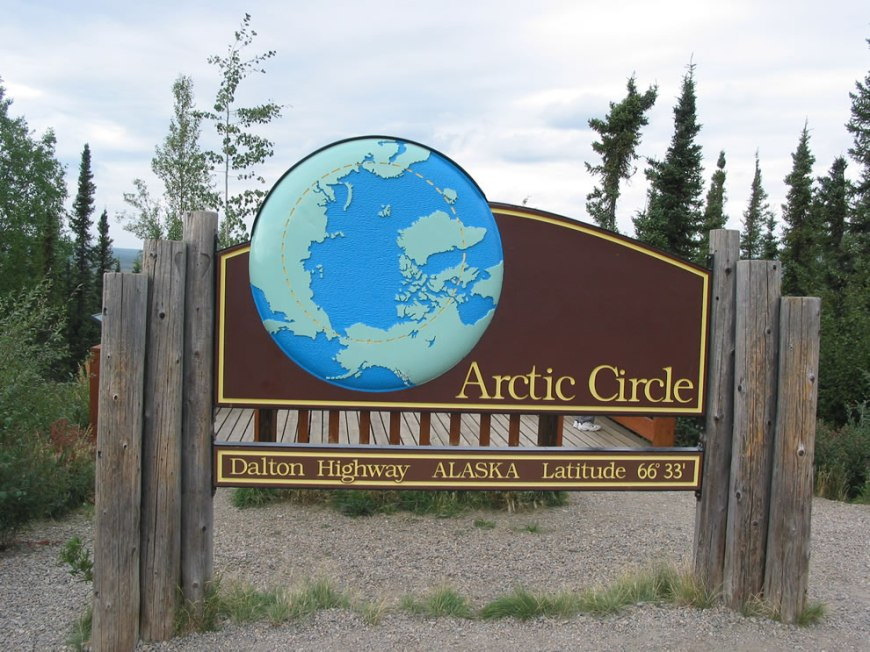 Road sign along the Dalton Highway marking the location of the Arctic Circle in Alaska