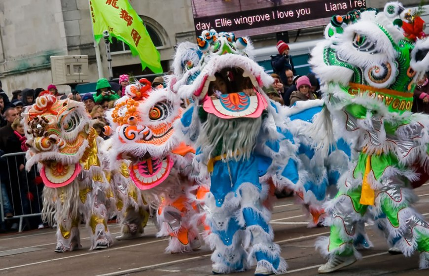 Dancing lions celebrating chinese lunar year the year of the dragon