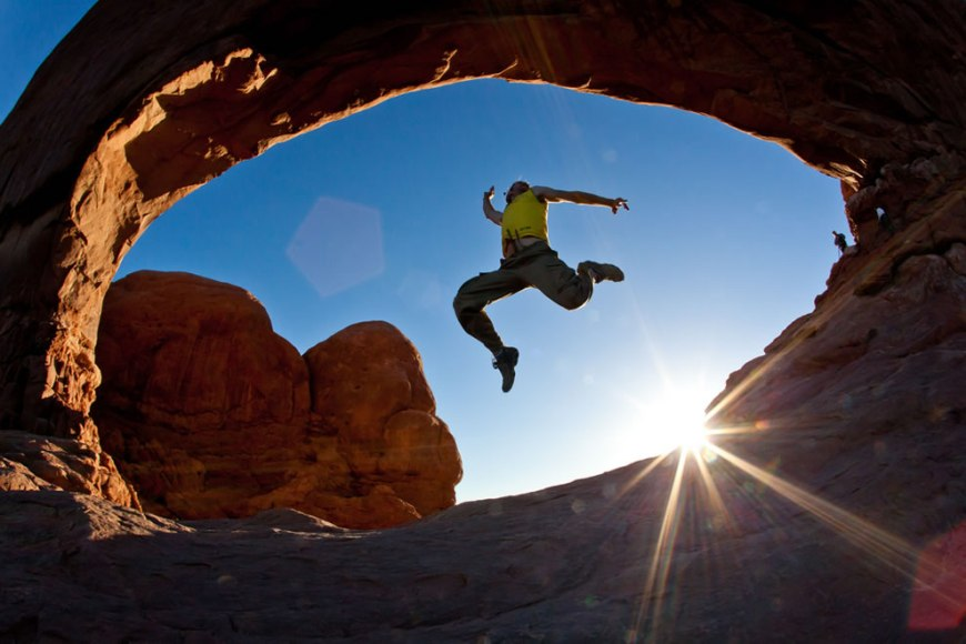 Dawn at Arches National Park, adventure seekers jumping arches, moab utah