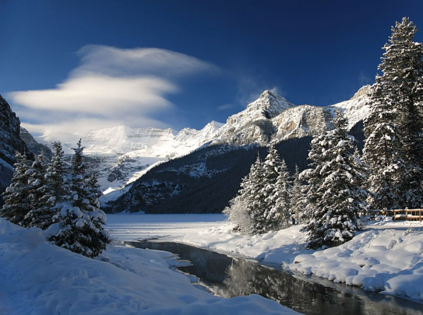 A winter cloud sweeps over the Victoria Glacier at Lake Louise, Canada
