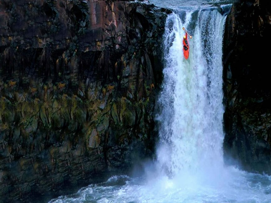extreme kayaking down waterfall