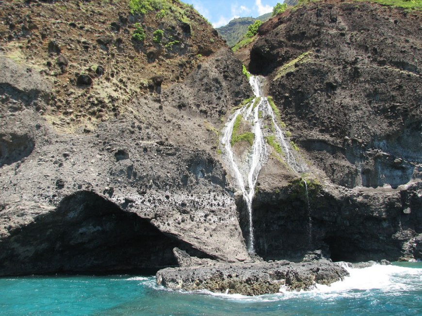 Napali Sea Breeze Tour - waterfall over sea cave
