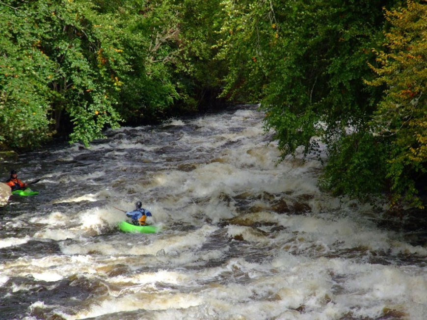 Whitewater kayaker on the Dochart River in Killin