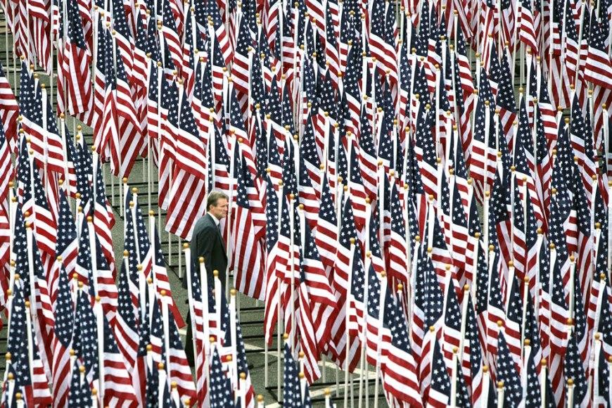 A man walks through the Healing Field flag display near the Pentagon Memorial
