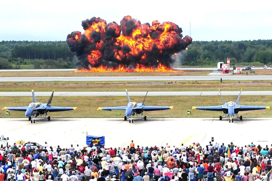 A pyrotechnics display is detonated near the flight line at Naval Air Station Brunswick during The Great State of Maine Air Show, Brunswick, Maine