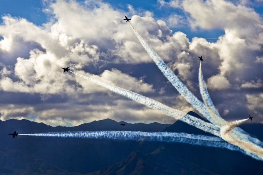 Blue Angels perform aerobatic maneuvers for military and civilians during the Kaneohe Bay Air Show at Marine Corps Air Station Kaneohe Bay on Marine Corps Base Hawaii
