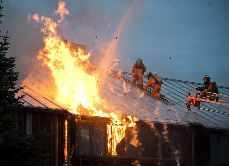Firefighters battle a blaze at part of the lodging facilities of Joint Base Elmendorf-Richardson, Alaska