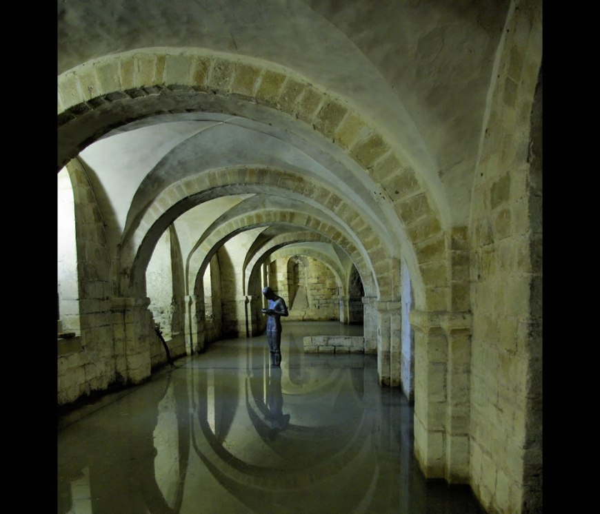 Statue in the flooded Crypt underneath Winchester Cathedral