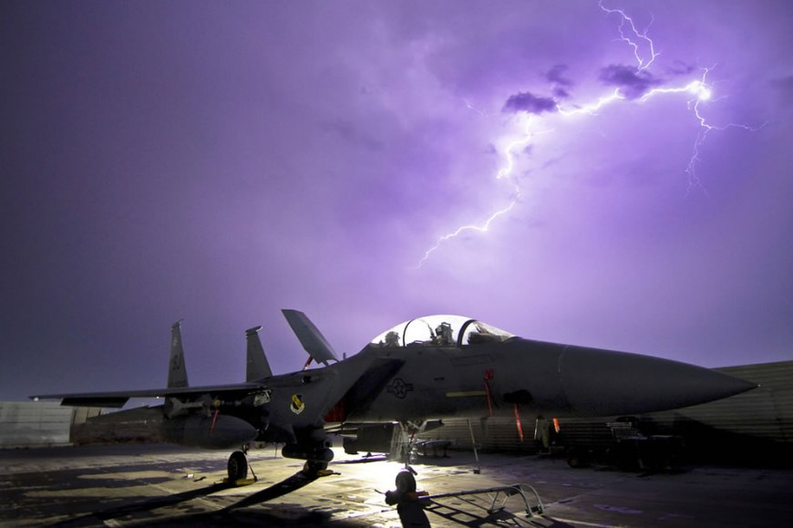 USAF F-15E Strike Eagle fighter aircraft is illuminated by a lightning storm near Bagram Air Field, Afghanistan