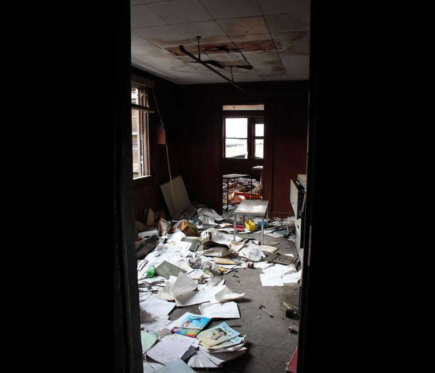A trashed office with hollow floor at abandoned Emge Food Plant
