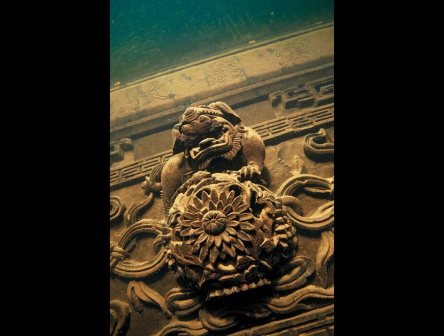 Intricate carvings engraved on buildings as seen when a group of Chinese archaeologists rediscovered the the underwater Shi cheng City