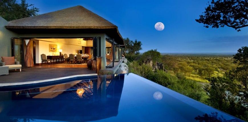 Infinity pool and full moon at Bilila Lodge Kempinski in Tanzania's Serengeti National Park