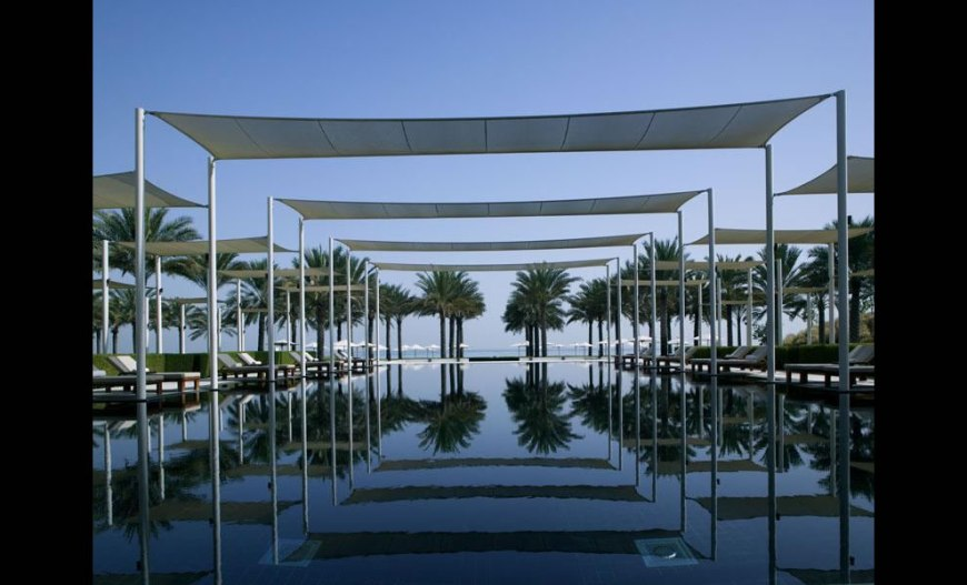 Serai infinity pool: Sultanate of Oman -- The Chedi Muscat with view of the Gulf of Oman or the Hajar mountains
