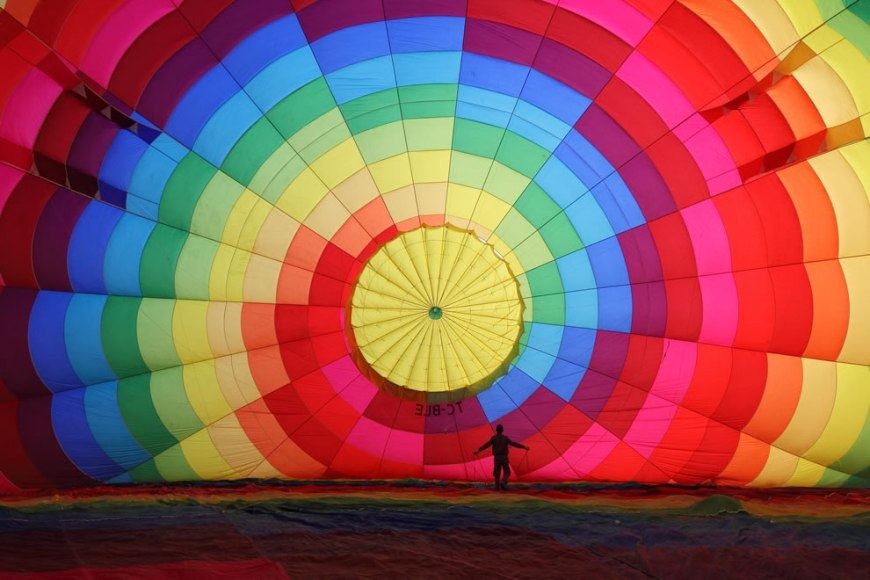 #16 – 23 votes in Final; A hot air balloon being inflated before air trip over Cappadocia, central Turkey, as seen from inside